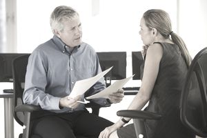 Man and woman participating in an employment exit interview