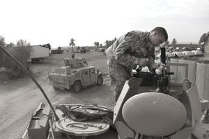 U.S. Soldier performs maintenance on a Browning .50 Cal Heavy-Barrel Machine Gun