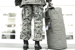 Soldier with a duffle bag in airport