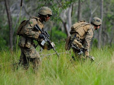 Two U.S Marines run into position whilst participating in a live fire excercise on July 31, 2013 near Rockhampton, Australia.