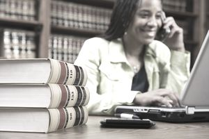 Woman sitting at desk in front of legal books