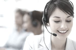Smiling call center employee during a telephone conversation