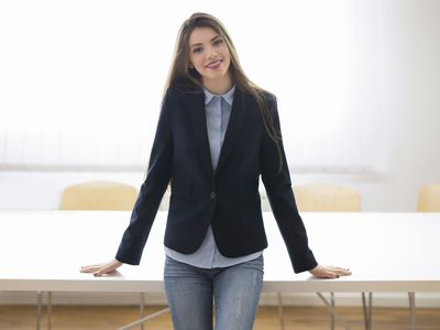Business woman in jeans and a blazer