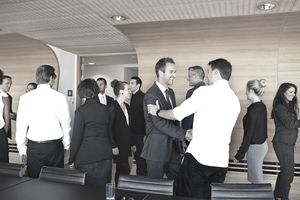 Business people making handshake in meeting room