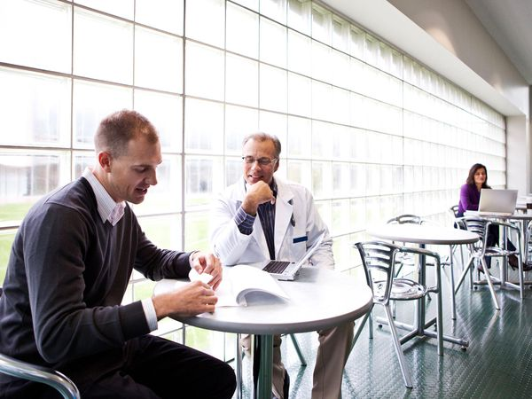 Salesman and doctor in a casual meeting