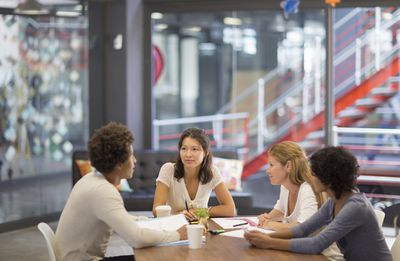 Attendees at a group job interview try to assess their candidate's conflict resolution skills.
