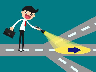 Cartoon of person with a flashlight at a road cross way determining the best career path.
