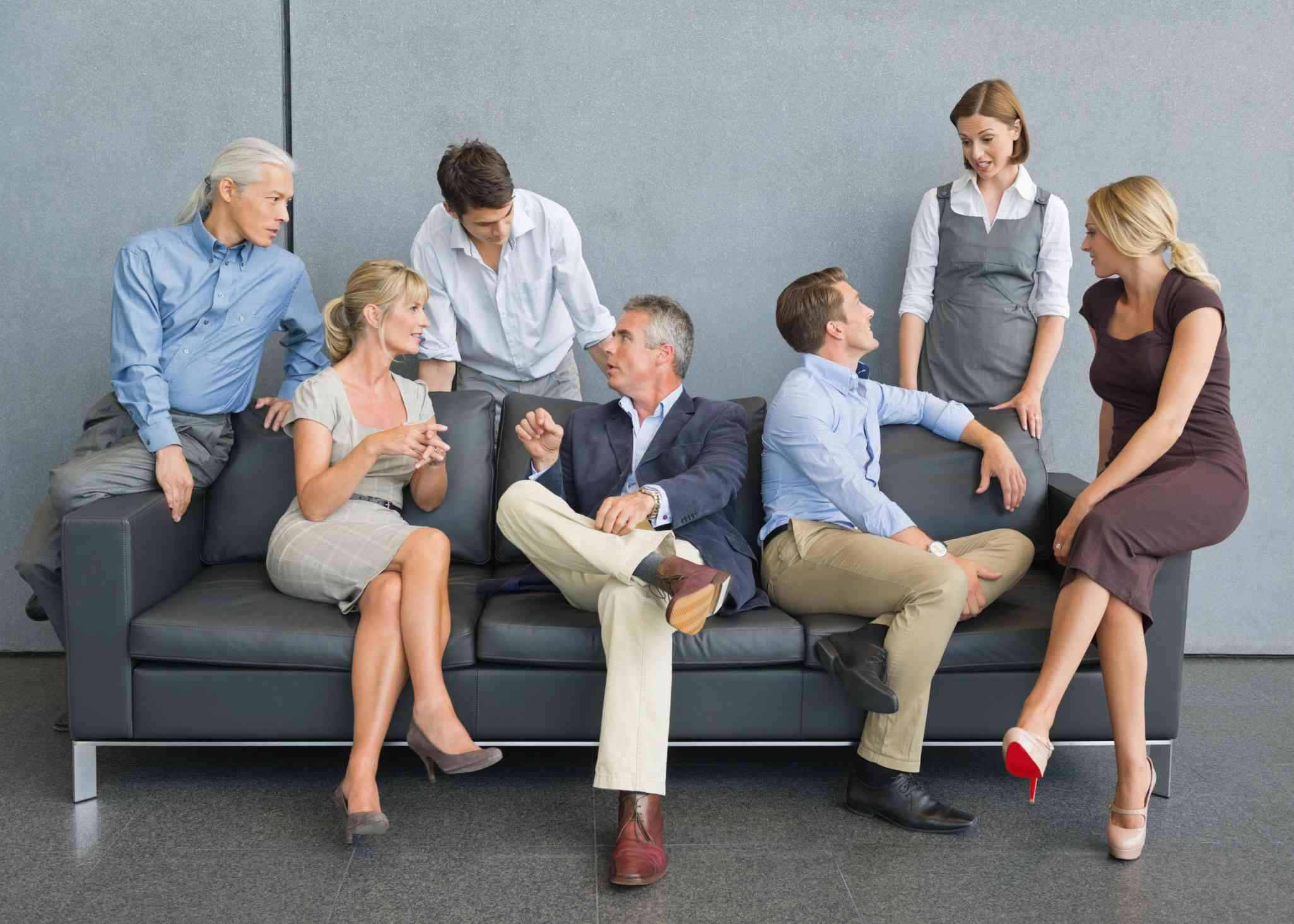 A group of men and women in business casual clothes