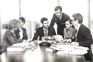 Work associates sitting around a conference table