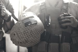American flag on helmet of US Marine soldier.
