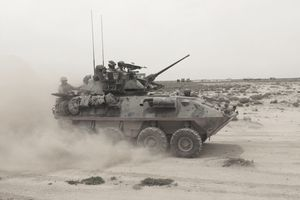 A Marine Corps Light Armored Vehicle kicks up a cloud of dust.