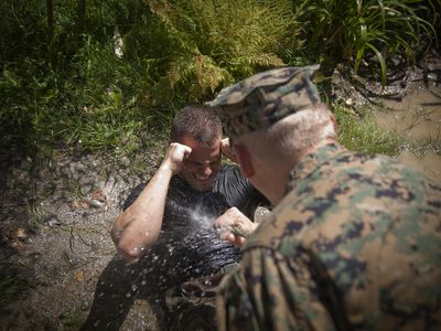 A drill instructor with recruit