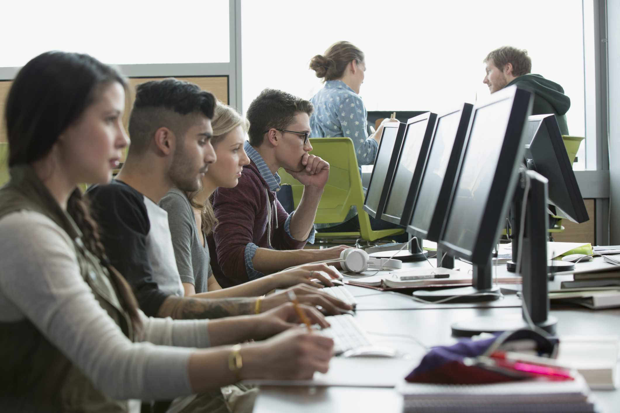 Adult students at computers