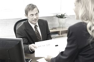 Businessman handing a resume to a businesswoman