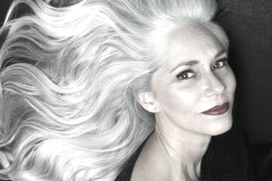 Mature female model with flowing gray hair