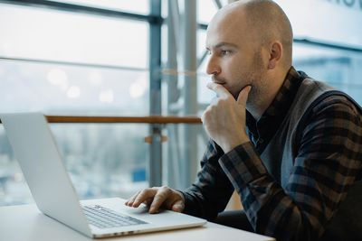 Man reviewing document on laptop