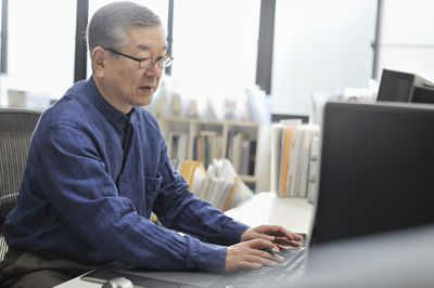 Senior man working on a computer in the office