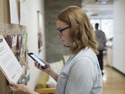 Woman checking job postings in office