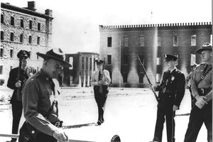 Corrections officers in prison yard