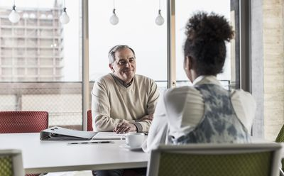 Businessman and young woman in conference room