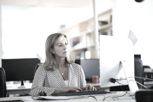Confident businesswoman using computer in office