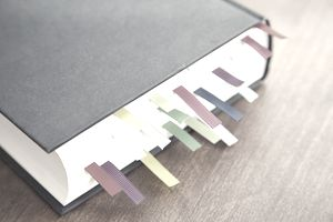 Book with multi-colored bookmarks.