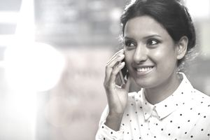 Woman talking into her mobile phone.