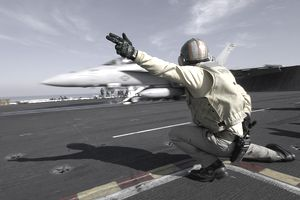 Catapult officer (aka shooter) directing aircraft for takeoff