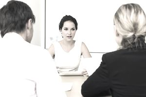Woman answering questions during a third job interview