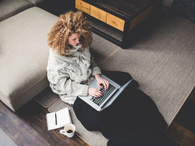 writer working at home on computer