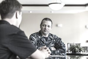 Civilian Teenager Meeting With US Navy Recruiter