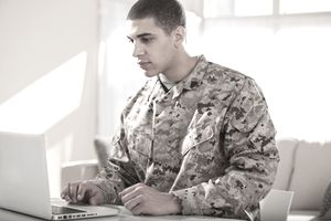 US Marine Corps soldier working on laptop