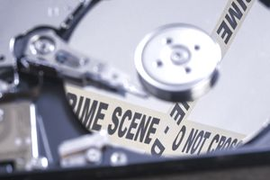 Close Up Of Hard Drive With Crime Scene tape
