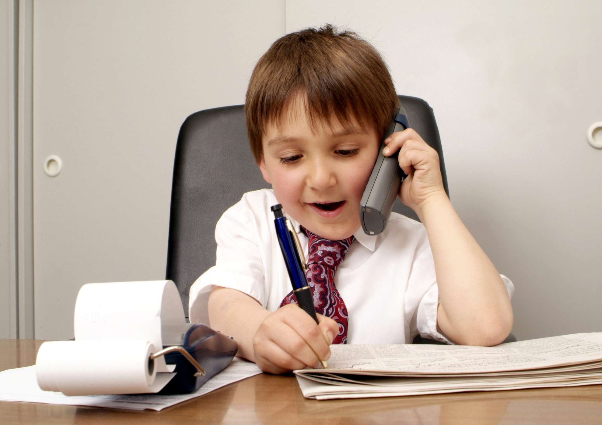 Boy playing office