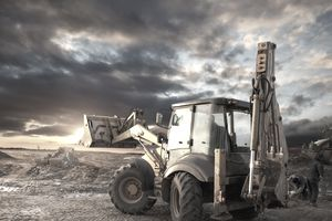an earth mover at a construction site at sundown