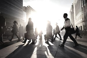 Business people walking to work in the early morning