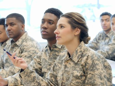 Young female cadet asks question in military training class