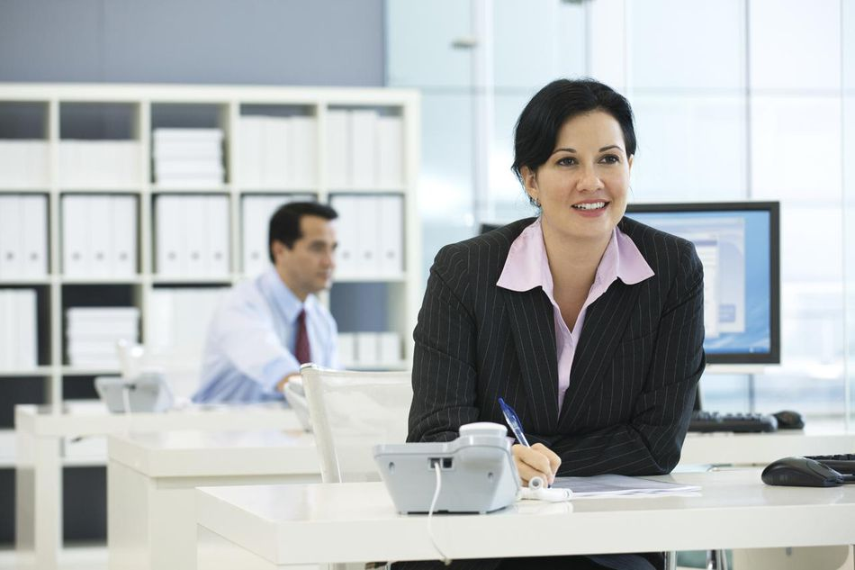 Woman working in large open modern office