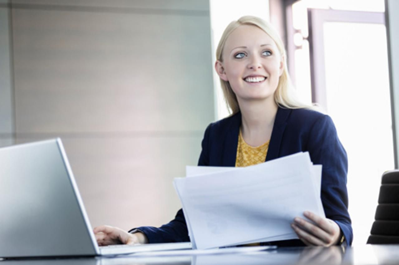 Woman reading cover letters