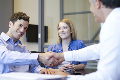 Businessman shaking hands with coworker