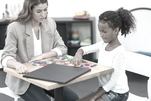 Occupational therapist working with child