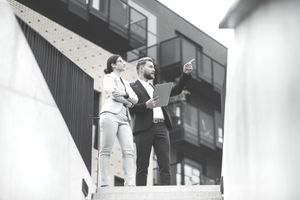 Commercial real estate agent and businesswoman looking at a commercial property