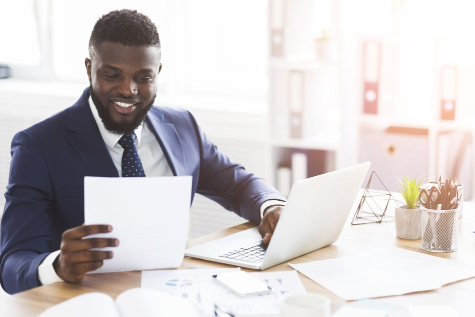 Businessman reviewing cover letter