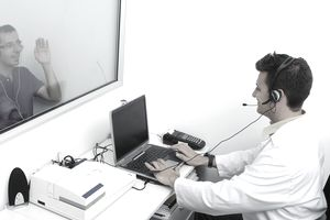 Man administering hearing test