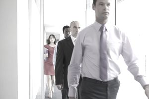 Business people walking down corridor