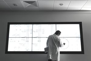 Data Scientist circling information on a screen