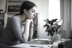 Worried woman using laptop to look for a job