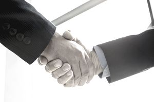 Businesmen shaking hands in conference room