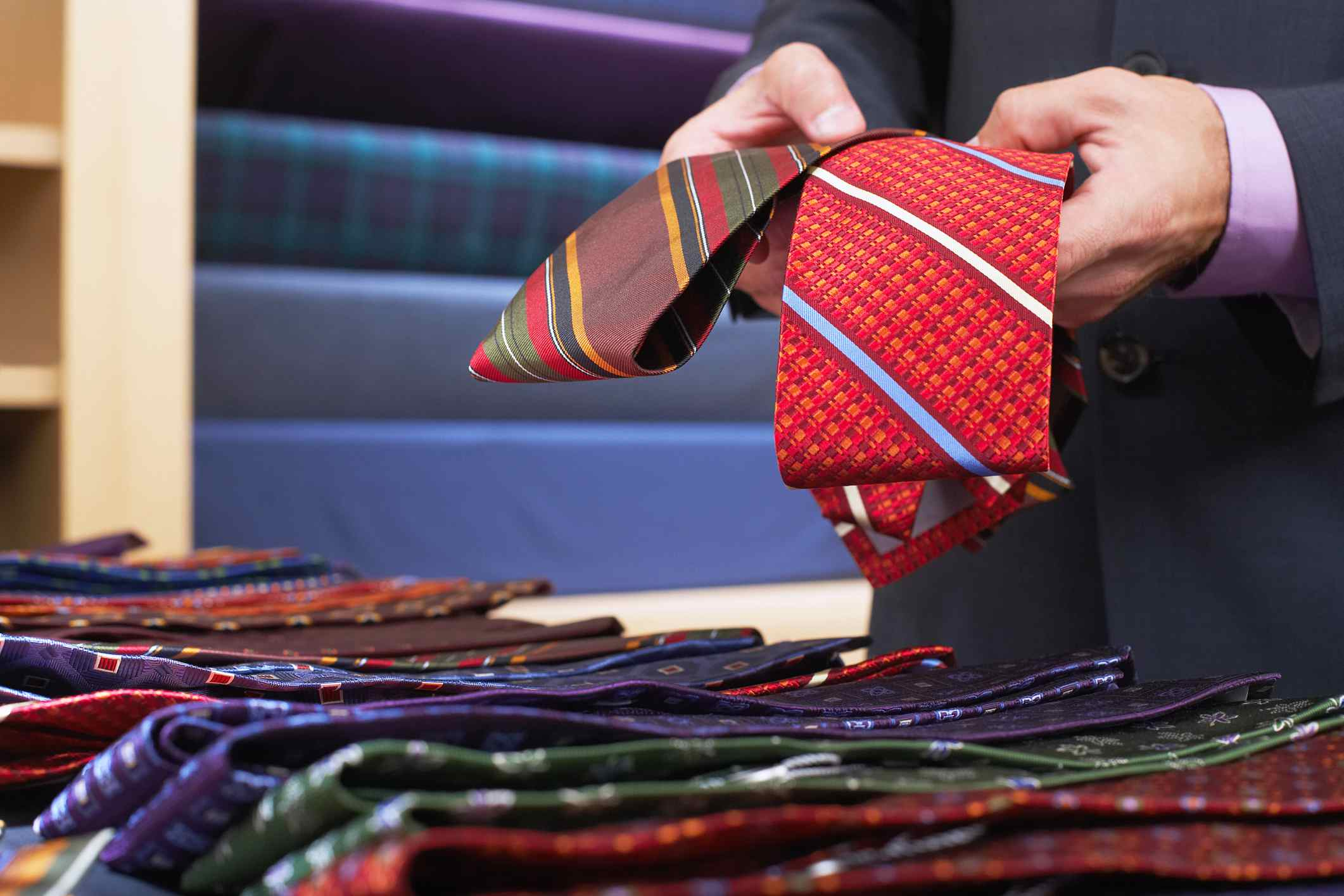 Man comparing ties in the store