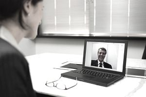 Businesswoman using video conference call for an online job interview.
